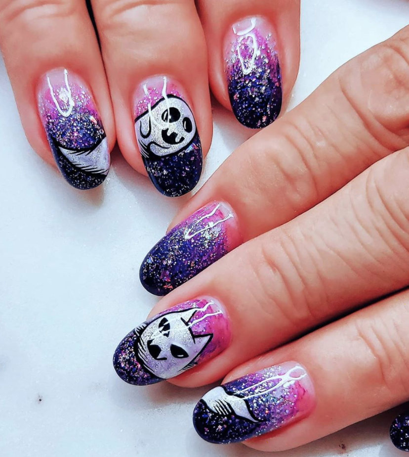 """<p>Instead of a traditional white ghost, liven up your nails like <a href=""""https://www.instagram.com/p/CAJlN2blPFu/"""" rel=""""nofollow noopener"""" target=""""_blank"""" data-ylk=""""slk:Hawaii-based nail artist Asami"""" class=""""link rapid-noclick-resp"""">Hawaii-based nail artist Asami</a>, by creating shimmery apparitions. </p><p><a class=""""link rapid-noclick-resp"""" href=""""https://www.livelovepolish.com/products/illimite-muse-nail-polish-picasso-collection"""" rel=""""nofollow noopener"""" target=""""_blank"""" data-ylk=""""slk:SHOP POLISH"""">SHOP POLISH</a></p>"""