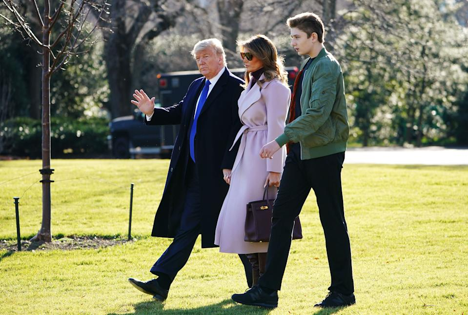 US President Donald Trump, First Lady Melania Trump and son Barron Trump make their way to board Marine One from the South Lawn of the White House in Washington, DC on January 17, 2020. Trump is traveling to Palm Beach, Florida.