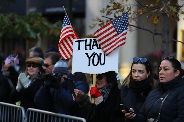 "<p>A spectator holds up a sign saying ""€œThank You""€ during the Veterans Day parade on Fifth Avenue in New York on Nov. 11, 2017. (Photo: Gordon Donovan/Yahoo News) </p>"