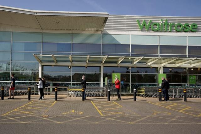 People observe social distancing while queuing at a Waitrose (Morgan Harlow/PA Wire)