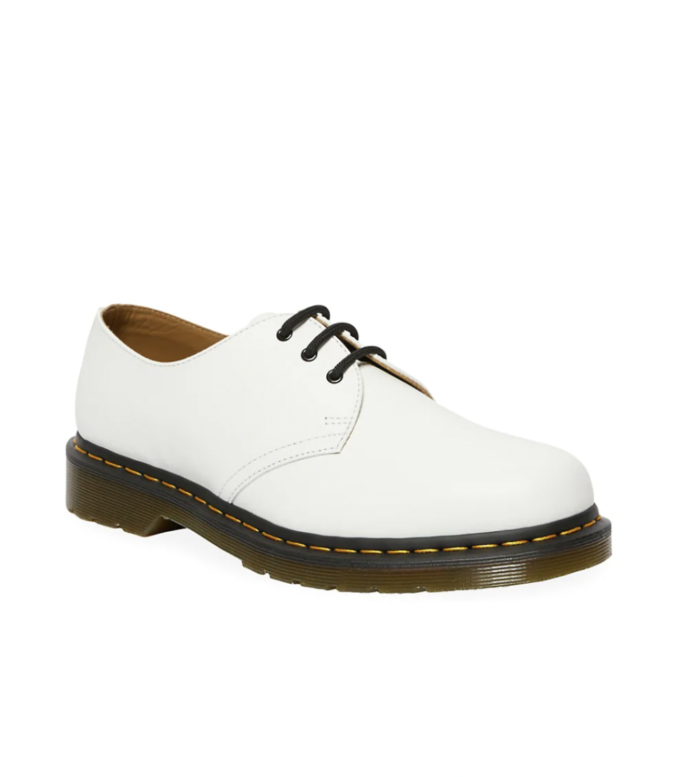 """<p><strong>Dr. Martens</strong></p><p>saksfifthavenue.com</p><p><strong>$120.00</strong></p><p><a href=""""https://go.redirectingat.com?id=74968X1596630&url=https%3A%2F%2Fwww.saksfifthavenue.com%2Fproduct%2Fdr.-martens-originals-1461-leather-oxford-shoes-0400012695951.html&sref=https%3A%2F%2Fwww.esquire.com%2Fstyle%2Fmens-fashion%2Fg28186249%2Fbusiness-casual-shoes%2F"""" rel=""""nofollow noopener"""" target=""""_blank"""" data-ylk=""""slk:Shop Now"""" class=""""link rapid-noclick-resp"""">Shop Now</a></p><p>Into white, but really feeling sneakers? The Doc has got you covered with some slightly offbeat oxfords. Pair them with a straight-leg jean and button-up, or a cotton suit, and consider yourself minted. <br></p>"""