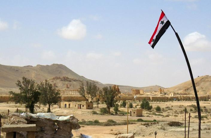 A Syrian flag flies above the ancient city of Palmyra after Syrian troops recaptured the city from the Islamic State group on March 27, 2016 (AFP Photo/)