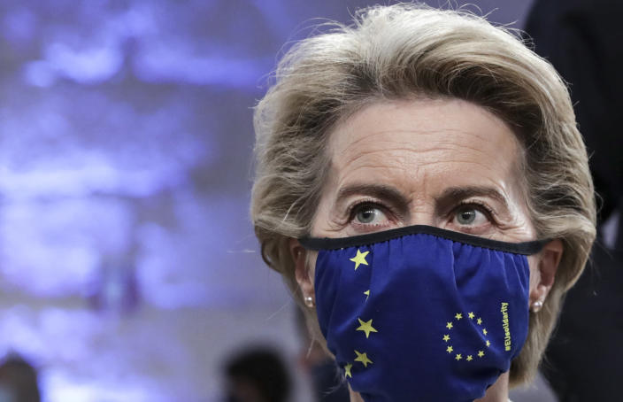 European Commission President Ursula von der Leyen wears a protective face mask with the EU stars as she waits for the start of the opening ceremony at an EU summit at the Alfandega do Porto Congress Center in Porto, Portugal, Friday, May 7, 2021. European Union leaders meet for a summit in Portugal on Friday, sending a signal they see the threat from COVID-19 on their continent as waning amid a quickening vaccine rollout. Their talks hope to repair some of the damage the coronavirus has caused in the bloc, in such areas as welfare and employment. (Tiago Petinga, Pool via AP)