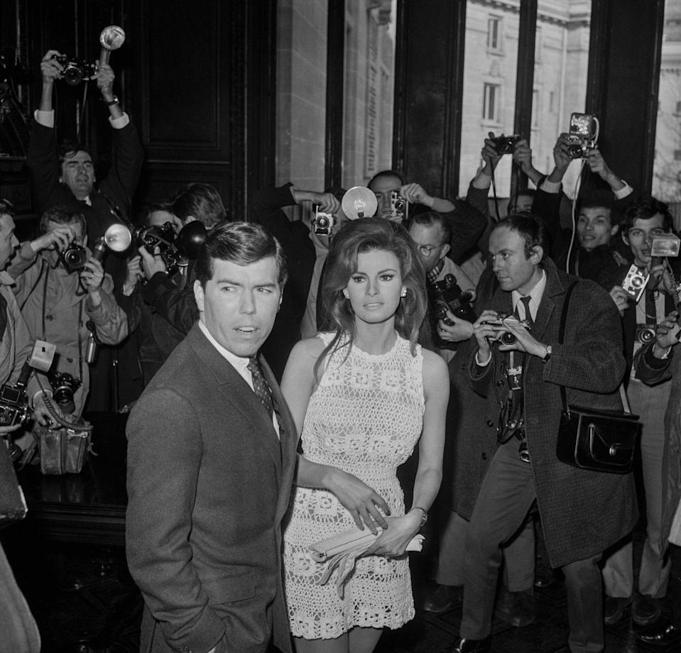 <p>Raquel Welch wore a white croquet sun dress to the courthouse in Paris to marry American film producer Patrick Curtis. The elopement was flooded with photographers who spotted the couple, ruining any chance of keeping it a secret.</p>
