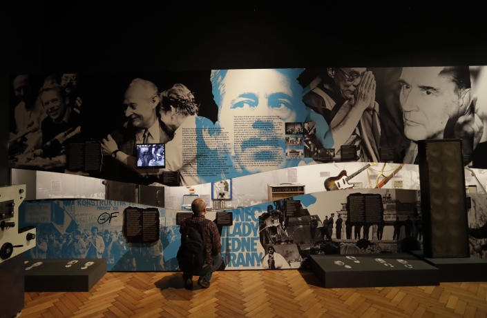 """In this picture taken on Tuesday, Nov. 12, 2019, a visitor views the exhibition """"The Technology in Dictatorships,"""" at the National technical Museum in Prague, Czech Republic. The exhibition, the first of that kind here, marks the 30th anniversary of the 1989 anti-communist Velvet Revolution by looking back at the surreal repression of a nation and resistance against it. (AP Photo/Petr David Josek)"""