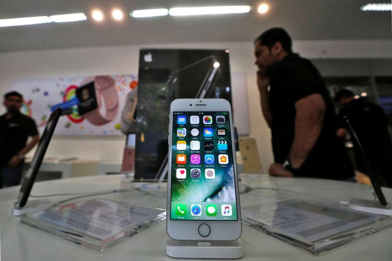 FILE PHOTO: An iPhone is seen on display at a kiosk at an Apple reseller store in Mumbai