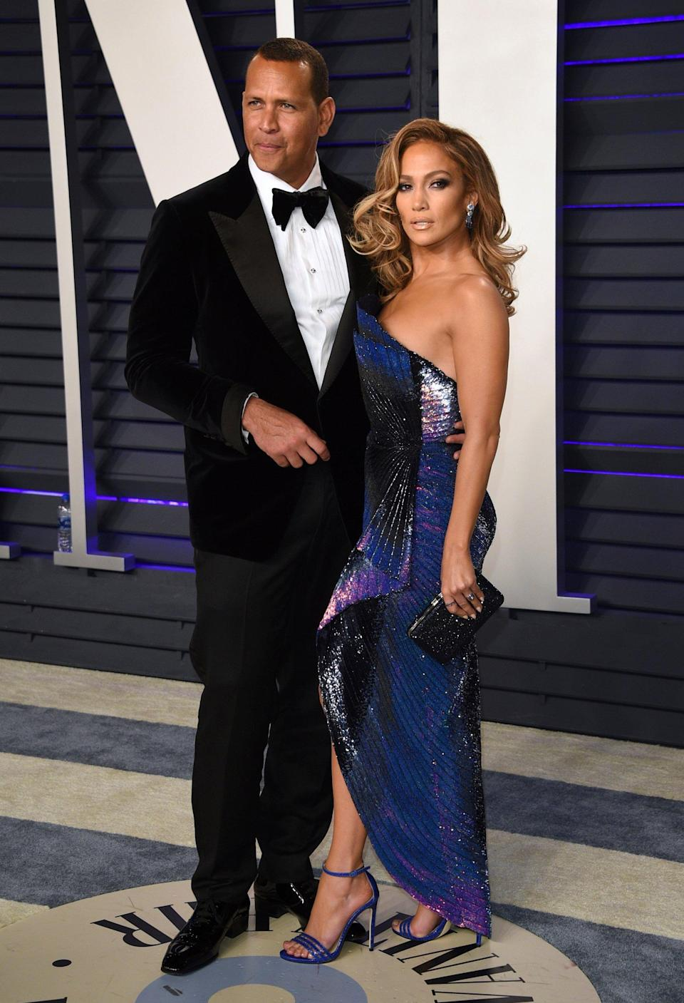 Accusations: Jennifer Lopez and Alex Rodriguez pictured at the Vanity Fair Oscars party last month (Invision/AP)