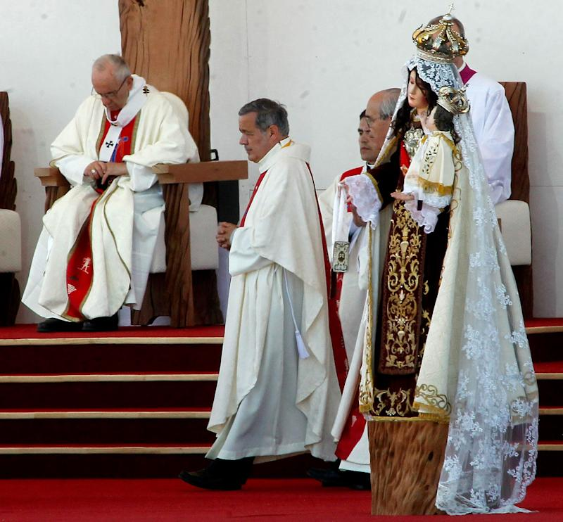 The bishop of Osorno, Juan Barros (center), takes part in an open-air mass celebrated by Pope Francis (left) at Maquehue airport in Temuco onJan. 17, 2018.