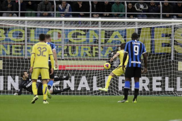 Verona's Valerio Verre scores his side's opening goal on a penalty kick, during the Serie A soccer match between Inter Milan and Hellas Verona, at the San Siro stadium in Milan, Italy, Saturday, Nov. 9, 2019. (AP Photo/Luca Bruno)