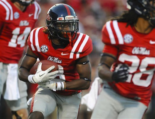Mississippi running back Jeff Scott (3) runs behind his blockers during the second quarter of an NCAA college football game in Oxford, Miss., Saturday, Sept. 8, 2012. (AP Photo/Austin McAfee)