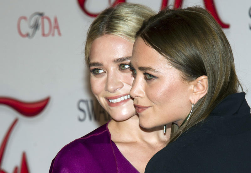 Ashley Olsen, left, and Mary-Kate Olsen arrive at the CFDA Fashion Awards on Monday, June 4, 2012 in New York. (Photo by Charles Sykes/Invision/AP)