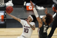 Arizona State's Jaelen House shoots around Washington State's Isaac Bonton during the second half of an NCAA college basketball game in the first round of the Pac-12 men's tournament Wednesday, March 10, 2021, in Las Vegas. (AP Photo/John Locher)