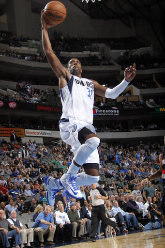 DALLAS, TX - NOVEMBER 5: O.J. Mayo #32 of the Dallas Mavericks flies in for the dunk against the Portland Trail Blazers on November 5, 2012 at the American Airlines Center in Dallas, Texas. (Photo by Glenn James/NBAE via Getty Images)