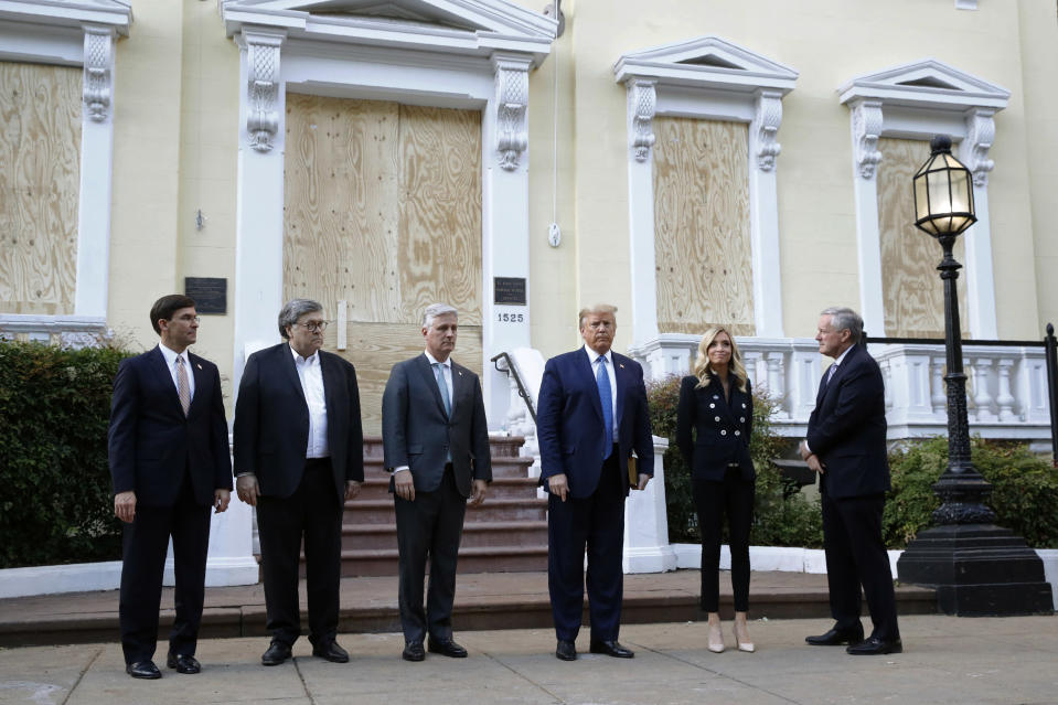 President Donald Trump stands outside St. John's Church across Lafayette Park from the White House Monday, June 1, 2020, in Washington. Part of the church was set on fire during protests on Sunday night. Standing with Trump are Defense Secretary Mark Esper, from left, Attorney General William Barr, White House national security adviser Robert O'Brien, White House press secretary Kayleigh McEnany and White House chief of staff Mark Meadows. (AP Photo/Patrick Semansky)