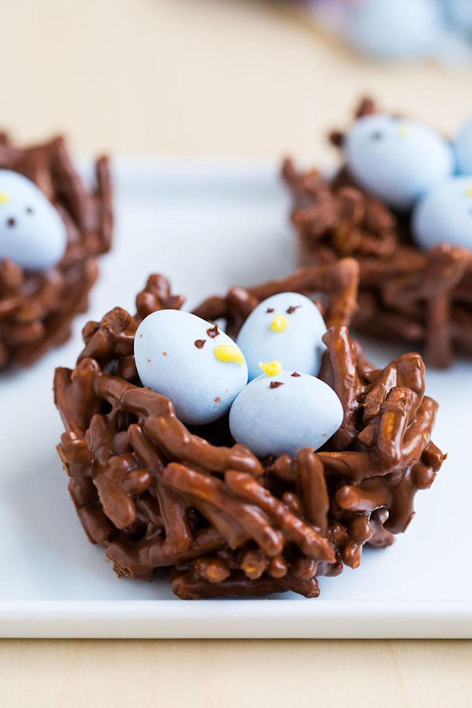 """<p><span>Chocolate-covered chow mein noodles form the base for these cozy-looking nests. Who knew putting little faces on Cadbury eggs would make them so adorable?</span></p><p><strong>Get the recipe at <a href=""""http://www.iheartnaptime.net/chocolate-egg-nest/"""" rel=""""nofollow noopener"""" target=""""_blank"""" data-ylk=""""slk:I Heart Naptime"""" class=""""link rapid-noclick-resp"""">I Heart Naptime</a>. </strong></p>"""