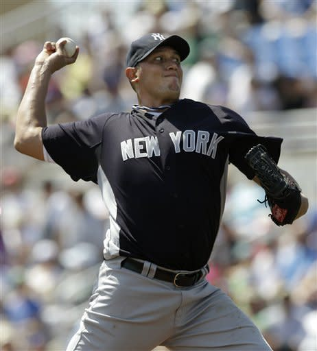New York Yankees starting pitcher Freddy Garcia winds up in the first inning against the Toronto Blue Jays during their spring training baseball game in Dunedin, Fla., Wednesday, March 14, 2012. (AP Photo/Kathy Willens)