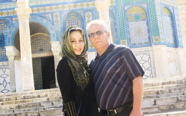 Sabrine Azraq, shown with her father in front of the Al-Aqsa Mosque, says she and her relatives in Toronto have been unable to avoid their phones and televisions since the latest violence broke out. Her mother's entire family lives in the West Bank.