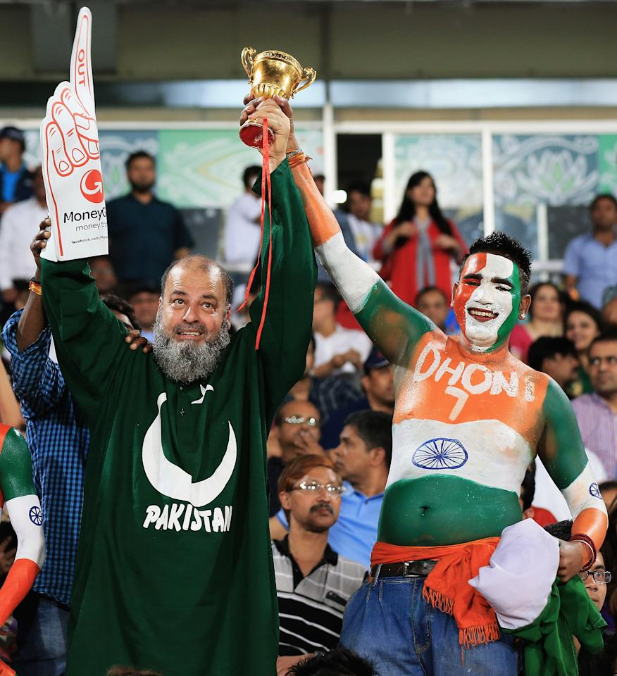 DHAKA, BANGLADESH - MARCH 21:  A Pakistan supporter and India supporter look on during the ICC World Twenty20 Bangladesh 2014 match between India and Pakistan match at Sher-e-Bangla Mirpur Stadium on March 21, 2014 in Dhaka, Bangladesh.  (Photo by Matthew Lewis-IDI/IDI via Getty Images)