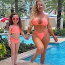 """<p>This mother-daughter duo <a href=""""https://people.com/parents/coco-austin-chanel-twinning-photos/"""" rel=""""nofollow noopener"""" target=""""_blank"""" data-ylk=""""slk:love a twinning moment"""" class=""""link rapid-noclick-resp"""">love a twinning moment</a>! Coco Austin soaked up the sun with her daughter Chanel in neon orange swimsuits from Wild Blush Bikinis. </p>"""