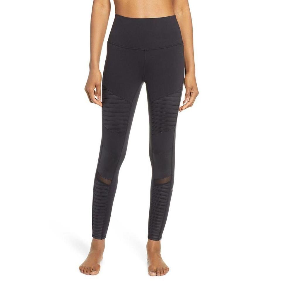 """<p><strong>Alo</strong></p><p>nordstrom.com</p><p><strong>$114.00</strong></p><p><a href=""""https://go.redirectingat.com?id=74968X1596630&url=https%3A%2F%2Fwww.nordstrom.com%2Fs%2Falo-high-waist-moto-7-8-leggings%2F5224960&sref=https%3A%2F%2Fwww.elle.com%2Ffashion%2Fshopping%2Fg36831494%2Ftravel-gift-ideas%2F"""" rel=""""nofollow noopener"""" target=""""_blank"""" data-ylk=""""slk:Shop Now"""" class=""""link rapid-noclick-resp"""">Shop Now</a></p><p>Leggings on planes is an absolute must.</p>"""