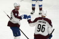 Colorado Avalanche defenseman Cale Makar (8) celebrates his goal with right wing Mikko Rantanen during the first period of an NHL hockey game against the Los Angeles Kings Saturday, May 8, 2021, in Los Angeles. (AP Photo/Marcio Jose Sanchez)