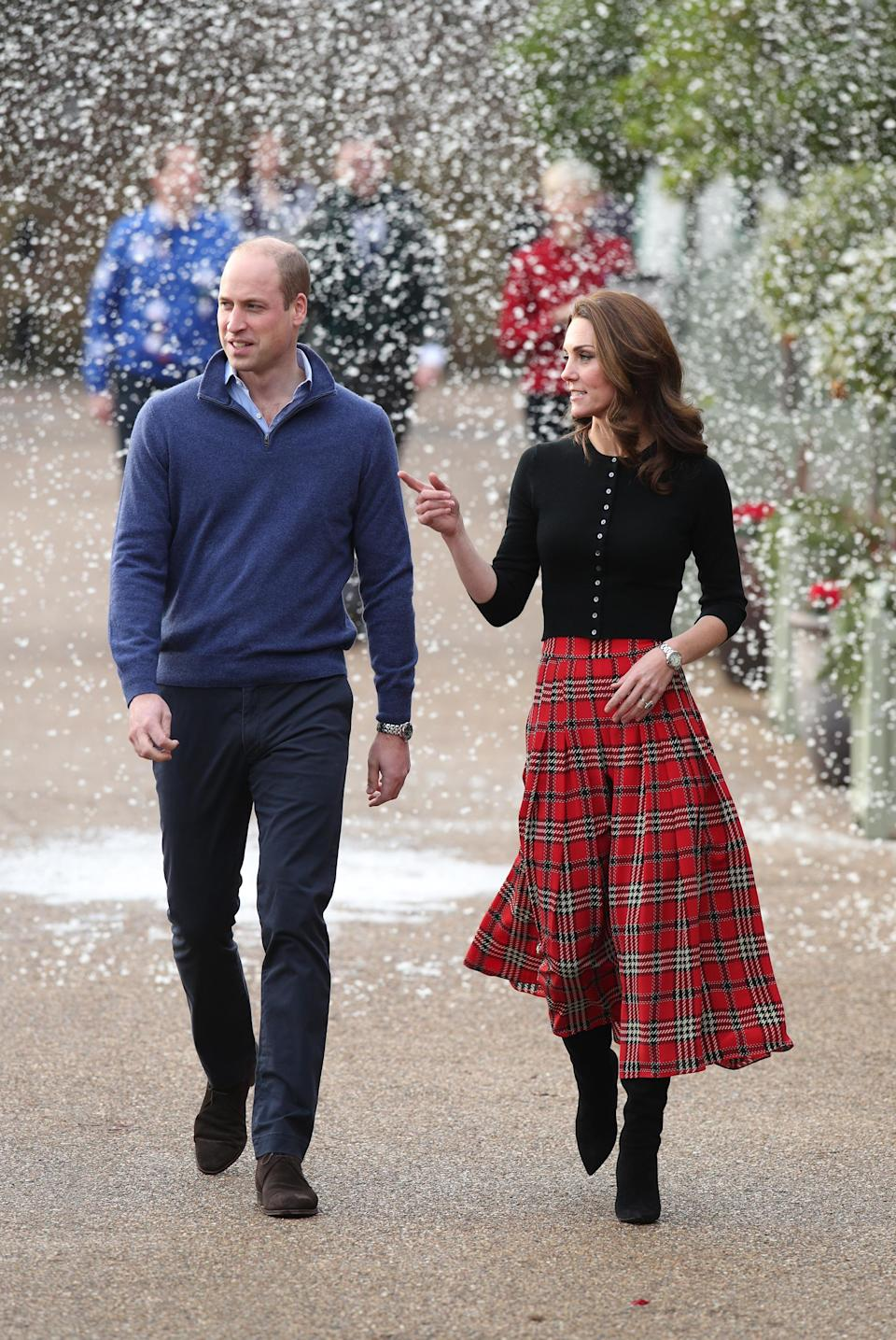 <p>On December 4, the Duke and Duchess of Cambridge threw a Christmas party at Kensington Palace for families and children of deployed personnel from RAF Coningsby and RAF Marham serving in Cyprus. Kate wore a tartan old-season Emilia Wickstead midi skirt and £209 Brora cardigan. <em>[Photo: Getty]</em> </p>