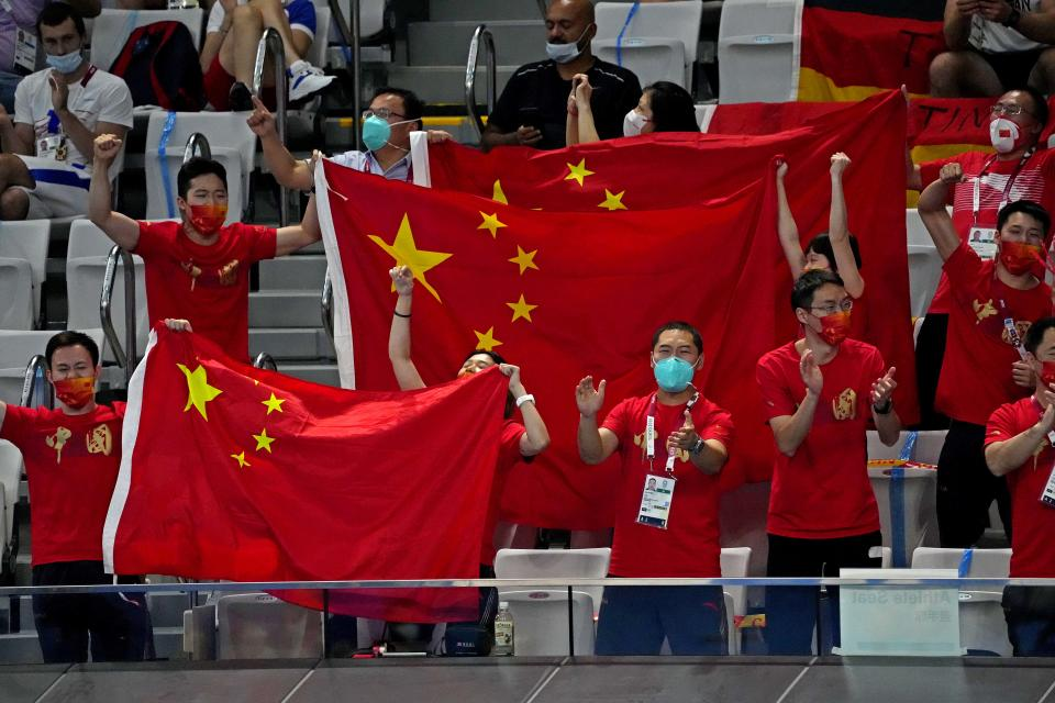 Aug 5, 2021; Tokyo, Japan; People in the stands cheer for Hongchan Quan in the women's diving 10m platform during the Tokyo 2020 Olympic Summer Games at Tokyo Aquatics Centre. Mandatory Credit: Robert Deutsch-USA TODAY Sports