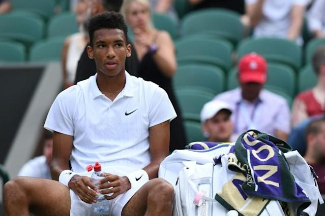Arthur Ashe? Auger-Aliassime's Wimbledon hopes like the rest of 'NextGen' burnt out in first week (AFP Photo/Ben STANSALL)