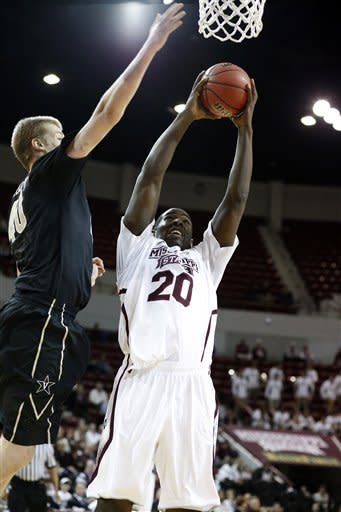 Mississippi State forward Gavin Ware (20) attempts a shot at the basket as Vanderbilt center Josh Henderson (40) tries to block in the first half of their NCAA college basketball game in Starkville, Miss., Saturday, Feb. 23, 2013. (AP Photo/Rogelio V. Solis)