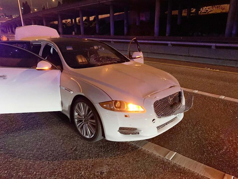 Early on 4 July, a photo shows the car of Dawit Kelete who is suspected of driving into a protest on Interstate 5 in Seattle. The city has been the site of prolonged unrest following the police killing of George Floyd in Minneapolis: Washington State Patrol via AP