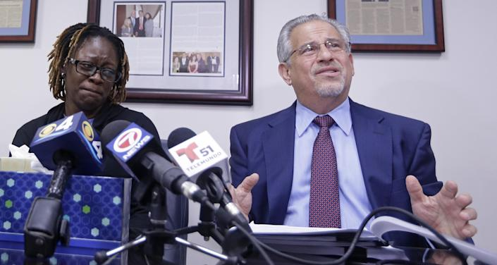 Attorney Howard M. Talenfeld, right, talks to reporters as Gina Alexis, left, mother of 14-year-old Nakia Venant, who livestreamed her suicide on Facebook over the weekend, listens, during a news conference, Wednesday, Jan. 25, 2017, in Plantation, Fla. Nakia Venant's suicide is at least the third to be livestreamed nationally in the last month. (AP Photo/Alan Diaz)