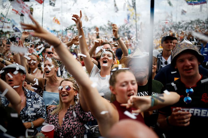 FILE PHOTO: Revellers watch Years & Years performing during Glastonbury Festival in Somerset