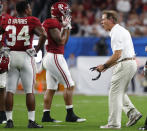 Alabama head coach Nick Saban, screams at tight end Irv Smith Jr. (82) and running back Damien Harris (34), during the first half of the Orange Bowl NCAA college football game against Oklahoma, Saturday, Dec. 29, 2018, in Miami Gardens, Fla. (AP Photo/Wilfredo Lee)