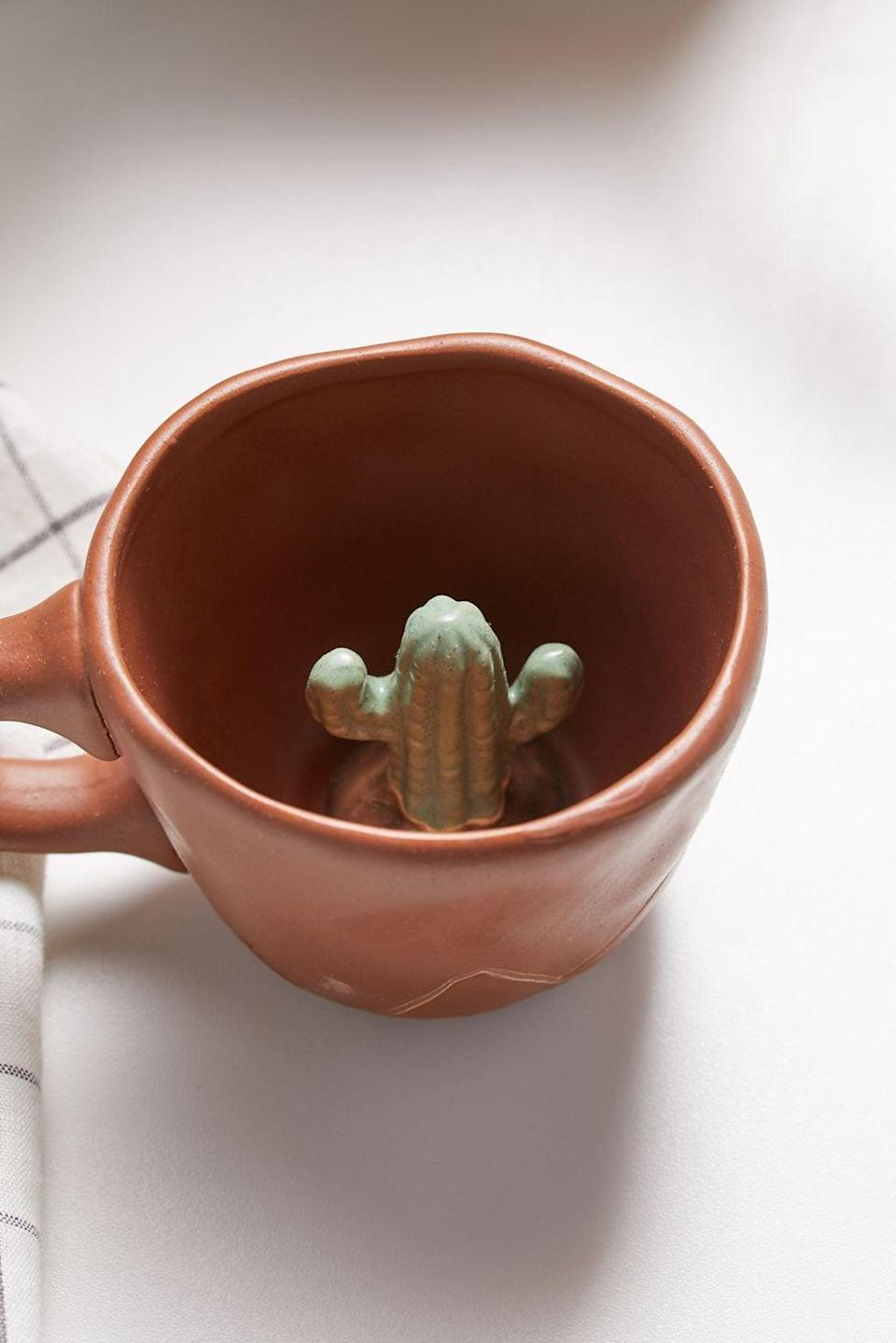 <p>Start off their mornings with the <span>Peekaboo Ceramic Mug</span> ($14). It has a cute surprise at the bottom of their mug. It also comes in green with flower mushroom detailing.</p>