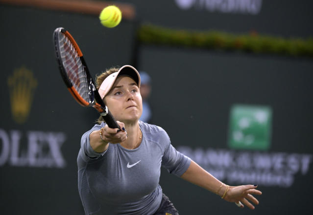 Elina Svitolina, of Ukraine, returns a shot to Bianca Andreescu at the BNP Paribas Open tennis tournament Friday, March 15, 2019, in Indian Wells, Calif. (AP Photo/Mark J. Terrill)