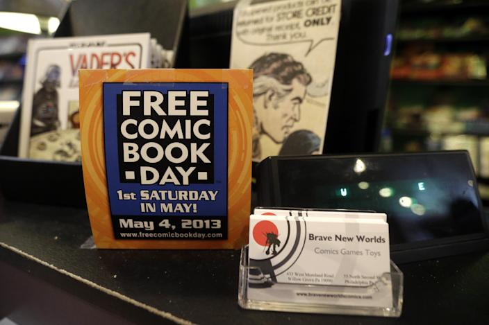 Shown is an advertisement for Free Comic Book Day at Brave New Worlds, Wednesday, May 1, 2013, in Philadelphia. When the doors open Saturday, May 4 for Free Comic Book Day the annual event that's grown from a few scattered stores hundreds upon hundreds worldwide publishers and purveyors of tales of fantastic heroes and nefarious villains will be eager to court new readers who, in spite of easy access to digital comics, are making time and spending money on comics printed on paper and increasing the demand for new books and titles. (AP Photo/Matt Rourke)