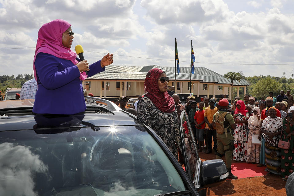 FILE - In this Tuesday, March 16, 2021, file photo, Tanzania's then Vice President Samia Suluhu Hassan, left, speaks during a tour of the Tanga region of Tanzania. Samia Suluhu Hassan has been sworn in Friday, March 19, 2021, as Tanzania's president, making history as the country's first woman in the position following the death of her predecessor John Magufuli. (AP Photo, File)