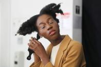 Lehlogonolo Machaba, the first openly transgender woman to compete for the Miss South Africa title combs her hair before a photo shoot in Johannesburg