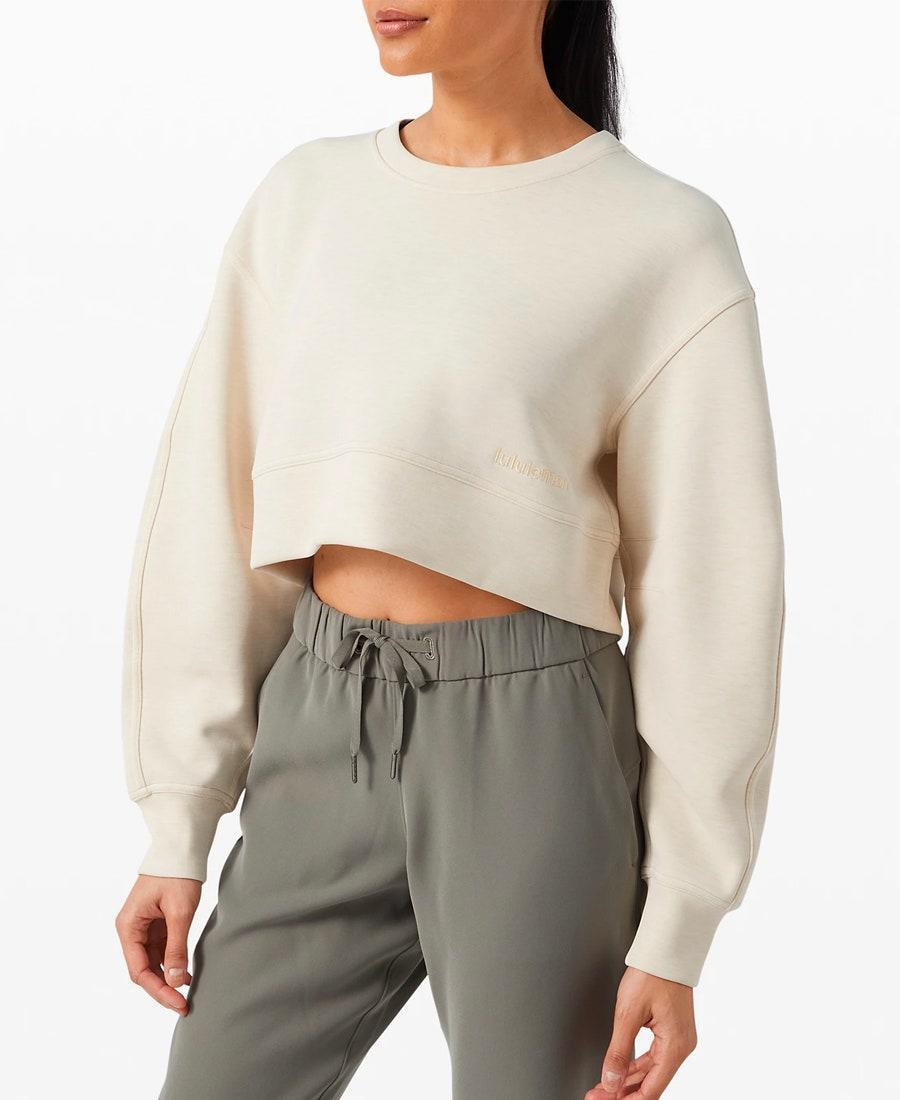 """One of the perks of spending the majority of your day inside? You can wear anything you want—including a cropped sweater in the middle of a thunderstorm. $118, Lululemon. <a href=""""https://shop.lululemon.com/p/womens-outerwear/Soft-Ambitions-Crop-Crew/_/prod9820291?"""" rel=""""nofollow noopener"""" target=""""_blank"""" data-ylk=""""slk:Get it now!"""" class=""""link rapid-noclick-resp"""">Get it now!</a>"""