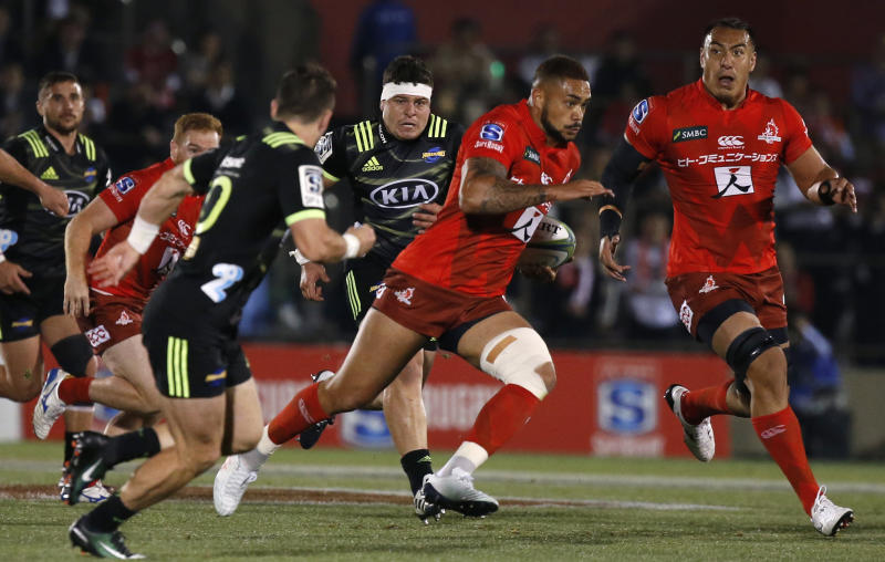 Sunwolves Rahboni Warren-Vosayaco, cenrter, runs at the Hurricanes defense during the Super Rugby game between the Hurricanes and Sunwolves in Tokyo, Friday, April 19, 2019. (AP Photo/Shuji Kajiyama)