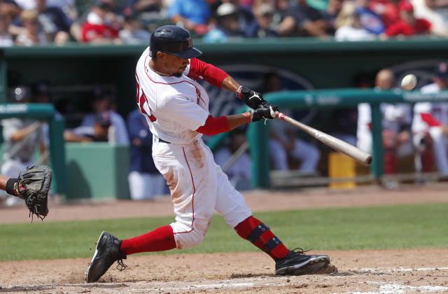 Boston Red Sox' Mookie Betts connects on a solo-home run in the seventh inning of a spring training baseball game against the Atlanta Braves Saturday, March 16, 2019, in Fort Myers, Fla. (AP Photo/John Bazemore)