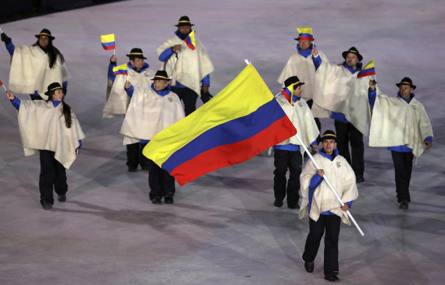 <p>Pedro Causil carries the flag of Colombia during the opening ceremony of the 2018 Winter Olympics in Pyeongchang, South Korea, Friday, Feb. 9, 2018. (AP Photo/Michael Sohn) </p>