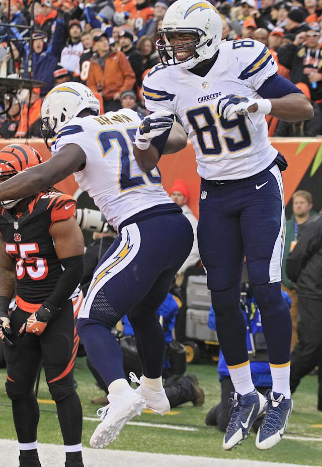 San Diego Chargers tight end Ladarius Green (89) celebrates his 4-yard touchdown catch against the Cincinnati Bengals with running back Ronnie Brown (23) in the second half of an NFL wild-card playoff football game on Sunday, Jan. 5, 2014, in Cincinnati. (AP Photo/Tom Uhlman)