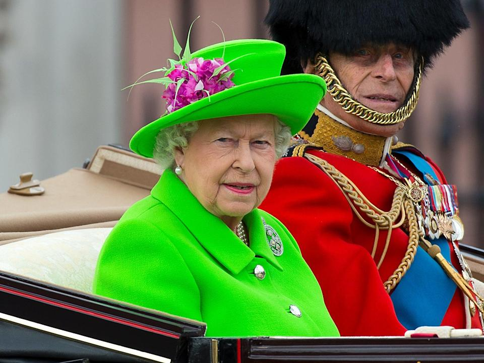 Queen Elizabeth II and Prince Philip, Duke of Edinburgh sit in a carriage during the Trooping the Colour parade, 11 June 2016 (Getty Images)