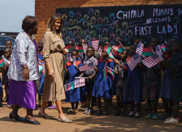 PHOTO: First lady Melania Trump is escorted by head teacher Maureen Masi as she arrives for a visit to Chipala Primary School, in Lilongwe, Malawi, Oct. 4, 2018. (Carolyn Kaster/AP)