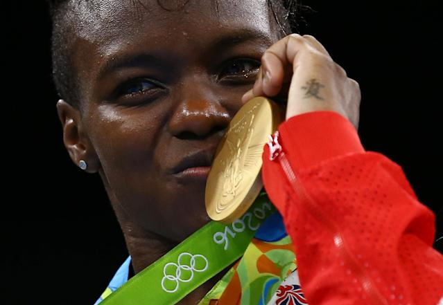 2016 Rio Olympics - Boxing - Victory Ceremony - Women's Fly (51kg) Victory Ceremony - Riocentro - Pavilion 6 - Rio de Janeiro, Brazil - 20/08/2016. Gold medallist Nicola Adams (GBR) of Britain poses with her medal. REUTERS/Peter Cziborra FOR EDITORIAL USE ONLY. NOT FOR SALE FOR MARKETING OR ADVERTISING CAMPAIGNS.