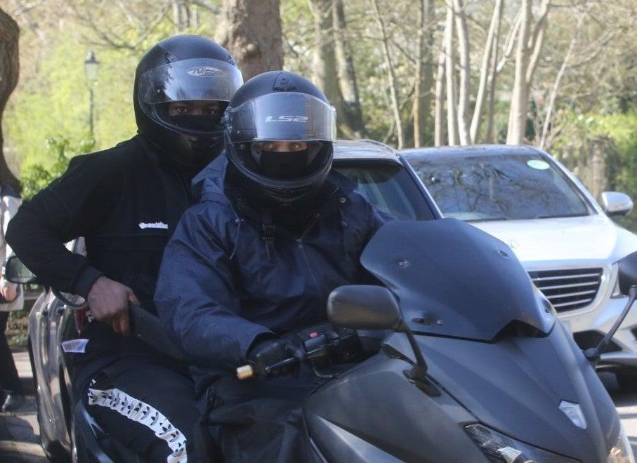 Two of the gang, Martin Delaney (rider) and Andrew Kiasuka-Kiakanda, with a knife on a mopedMetropolitan Plice