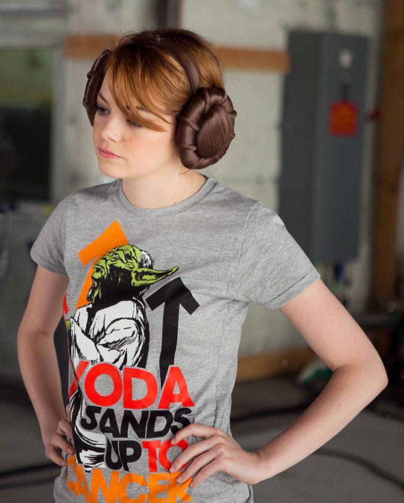 <p>Stone rocked her <em>Star Wars</em> gear and Princess Leia's signature hair buns when she played the character for a star-studded video promoting a collaboration between the sci-fi franchise and Stand Up to Cancer. (Photo: C.J. Schmidt/Stand Up To Cancer) </p>
