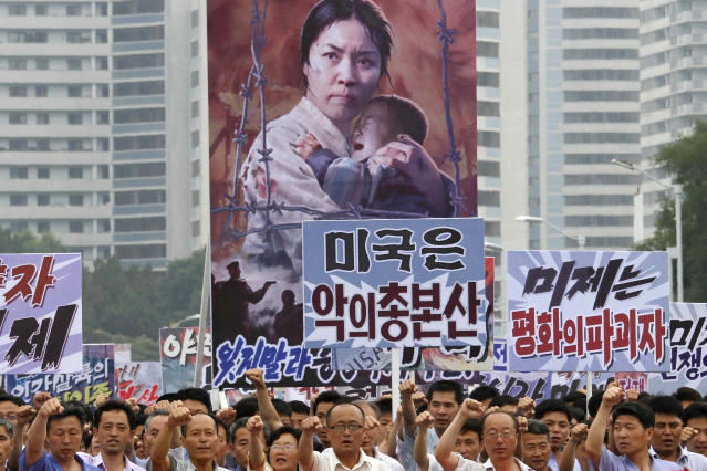 "FILE - In this June 25, 2017, file photo, tens of thousands of men and women pump their fists in the air and chant as they carry placards with anti-American propaganda slogans at Pyongyang's central Kim Il Sung Square, in North Korea, to mark what North Korea calls ""the day of struggle against U.S. imperialism"" – the anniversary of the start of the Korean War. In another sign of detente following the summit between North Korean leader Kim Jong Un and U.S. President Donald Trump, North Korea has opted not to hold this year's ""anti-U.S. imperialism"" rally. (AP Photo/Jon Chol Jin, File)"