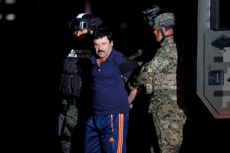 "FILE PHOTO: Joaquin ""El Chapo"" Guzman is escorted by soldiers during a presentation in Mexico City, January 8, 2016. REUTERS/Tomas Bravo/File photo"